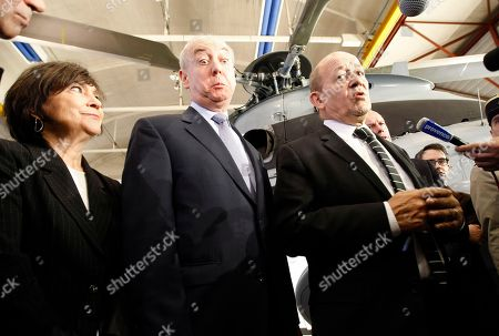 Jean Yves Le Drian, Dominique Maudet, Marie Arlette Carlotti French Defense Minister Jean Yves Le Drian, right, surrounded by Eurocopter Executive Vice President Global Business and Services Dominique Maudet, center, and France's Minister for Equality of Territories and Housing, Marie Arlette Carlotti, speaks with the media, during a visit at the Eurocopter company, in Marignane, near Marseille, southern France
