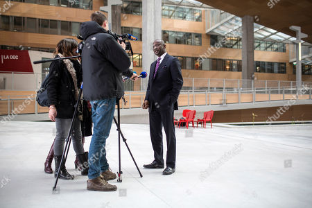 Stock Photo of Mali's Foreign Minister Tieman Coulibaly, right, answers journalists before a meeting with French Foreign Minister Laurent Fabius in Lyon, central France