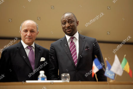 Stock Image of French Foreign Minister Laurent Fabius, left, and Mali's Foreign Minister Tieman Coulibaly, right, pose for journalists after a meeting in Lyon, central France
