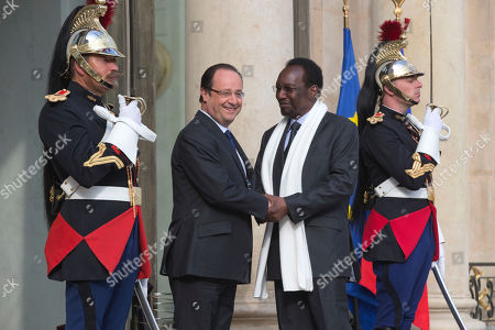 Francois Hollande, Dioncounda Traore France's President Francois Hollande, left, and Mali's President Dioncounda Traore, right, shake hands for the media at the Elysee Palace in Paris