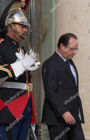 Francois Hollande France's President Francois Hollande, walks out of the entrance hall of the Elysee Palace as he awaits Mali's President Dioncounda Traore, in Paris