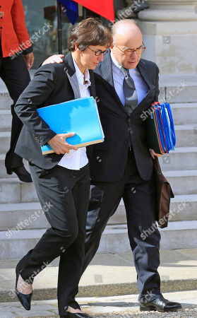 French budget minister Bernard Cazeneuve, right, and Sports Minister Valerie Fourneyron, left, leave the Elysee Palace following the weekly cabinet meeting in Paris