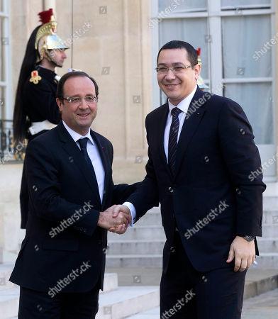Victor-Viorel Ponta, Francois Hollande France's President Francois Hollande, left, welcomes Romania's Prime Minister Victor-Viorel Ponta, right, at the Elysee Palace, Paris