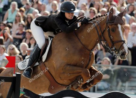 Reed Kessler of the U S rides her horse Cylana to finish second at the Grand Prix Hermes during the Saut Hermes Show Jumping at the Grand Palais, in Paris, Sunday, April, 14, 2013