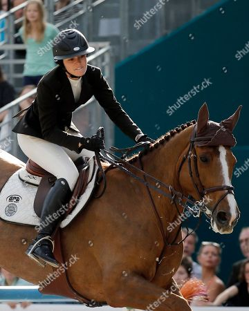 Reed Kessler of the US rides her horse Cylana to finish second at the Grand Prix Hermes during the Saut Hermes Show Jumping at the Grand Palais, in Paris, Sunday, April, 14, 2013
