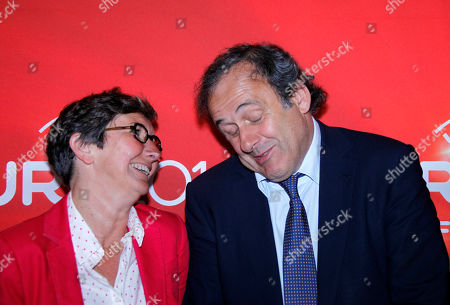 Michel Platini, Valerie Fourneyron UEFA President and former French soccer star Michel Platini, right, and French Sports Minister Valerie Fourneyron pose for photographers before a press conference on the preparations for the European Championship 2016 being held in France, in Lille, France