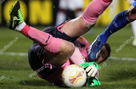 Bordeaux's goalkeeper Cedric Carrasso stops the ball during the Europa League soccer match against Dynamo Kiev in Bordeaux, southwestern France, Thursday, Feb.21, 2013