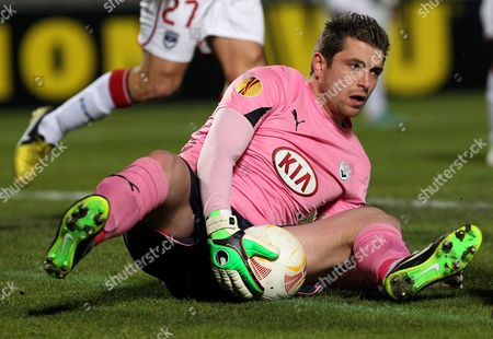 Bordeaux's goalkeeper Cedric Carrasso stops the ball during the Europa League soccer match against Dynamo Kiev in Bordeaux, southwestern France