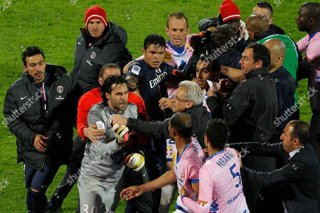 Paris Saint Germain's goalkeeper Salvatore Sirigu, left, fights with Evian's Saber Khalifa, center, after their French League One soccer match in Annecy, French Alps