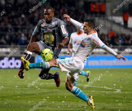 Jeremy Morel, Ronald Zubar Marseille's French defender Jeremy Morel, right, challenges for the ball with Ajaccio's French defender Ronald Zubar during their League One soccer match, in Marseille, southern France