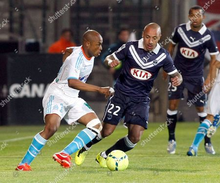 Marseille's Ghanaian forward Andre Ayew, right, challenges for the ball with Bordeaux's French defender Julien Faubert, during their League One soccer match, in Marseille, southern France