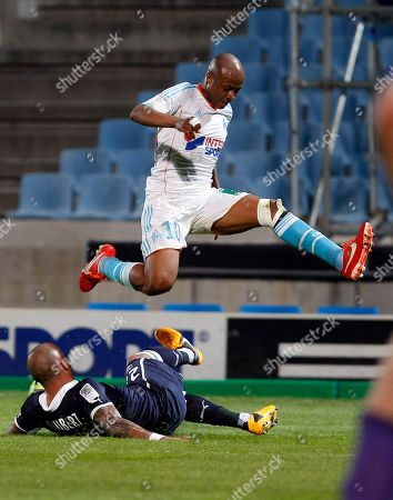 Andre-Pierre Gignac, Julien Faubert Marseille's French forward Andre-Pierre Gignac, right, challenges for the ball with Bordeaux's French defender Julien Faubert, during their League One soccer match, in Marseille, southern France