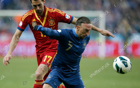 France's Franck Ribery, right, challenges Spain's Alvaro Arbeloa Coca during their World Cup 2014 qualifying soccer match at the Stade de France in Saint Denis, north of Paris