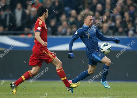 France's Franck Ribery, right, overruns Spain's Alvaro Arbeloa Coca during their World Cup 2014 qualifying soccer match at the Stade de France in Saint Denis, north of Paris