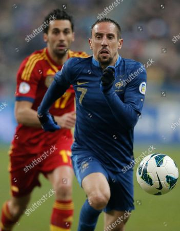 France's Franck Ribery, right, races with Spain's Alvaro Arbeloa Coca, during their World Cup Group I qualifying soccer match at Stade de France in Saint Denis, north of Paris, Tuesday, March, 26, 2013