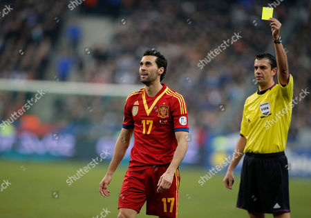 Viktor Kassai, Alvaro Arbeloa Coca Referee Viktor Kassai, right, shows the yellow card to Spain's Alvaro Arbeloa Coca during their 2014 World Cup Group I qualifying soccer match at Stade de France in Saint Denis, north of Paris, Tuesday, March, 26, 2013
