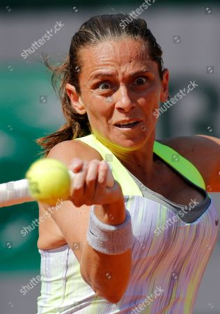 Stock Photo of Italy's Roberta Vinci returns the ball to France's Stephanie Foretz Gacon during their first round match of the French Open tennis tournament at the Roland Garros stadium in Paris