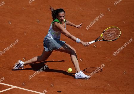 Italy's Roberta Vinci returns the ball to France's Stephanie Foretz Gacon during their first round match of the French Open tennis tournament at the Roland Garros stadium in Paris