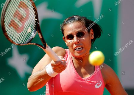 France's Stephanie Foretz Gacon returns the ball to Italy's Roberta Vinci during their first round match of the French Open tennis tournament at the Roland Garros stadium in Paris