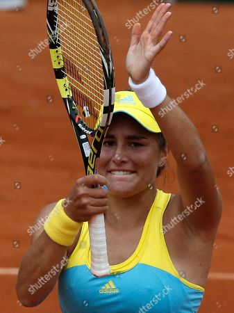 Puerto Rico's Monica Puig waves to spectators after defeating Russia's Nadia Petrova during their first round match of the French Open tennis tournament at the Roland Garros stadium in Paris