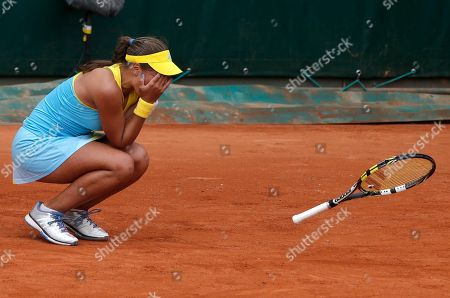 Puerto Rico's Monica Puig reacts as she defeats Russia's Nadia Petrova during their first round match of the French Open tennis tournament at the Roland Garros stadium in Paris