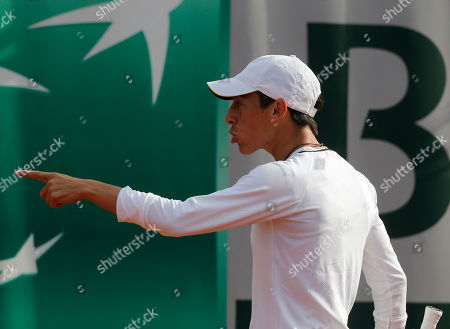 Italy's Francesca Schiavone reacts as she plays Hungary's Melinda Czink during their first round match of the French Open tennis tournament at the Roland Garros stadium in Paris