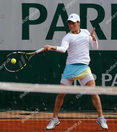 Italy's Francesca Schiavone returns the ball to Hungary's Melinda Czink during their first round match of the French Open tennis tournament at the Roland Garros stadium in Paris