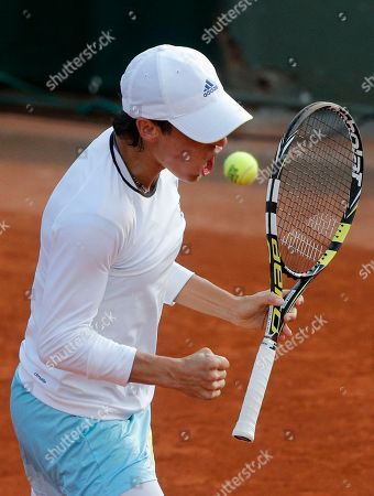 Italy's Francesca Schiavone reacts as she defeats Hungary's Melinda Czink during their first round match of the French Open tennis tournament at the Roland Garros stadium in Paris