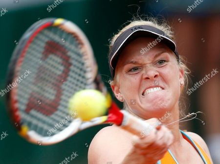 Melanie Oudin, of the U.S, returns the ball to China's Zheng Jie during their second round match of the French Open tennis tournament at the Roland Garros stadium in Paris