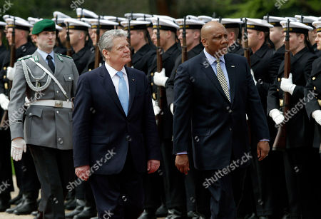 German President Joachim Gauck, left, welcomes King Letsie III. of Lesotho, right, with military honors for a meeting at the Bellevue Palace in Berlin, Germany