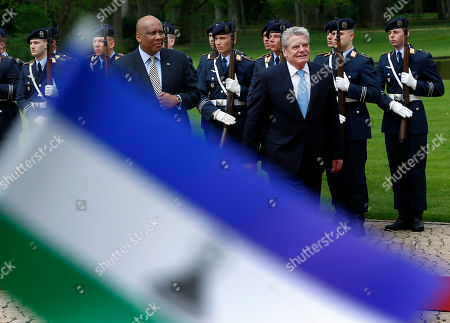 German President Joachim Gauck, front right, welcomes King Letsie III. of Lesotho, front left, with military honors for a meeting at the Bellevue Palace in Berlin, Germany