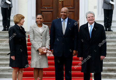 German President Joachim Gauck, right, and his partner Daniela Schadt, left, welcome King Letsie III. of Lesotho, second right, and his wife Masenate Mohato Seeiso, second left, for a meeting at the Bellevue Palace in Berlin, Germany