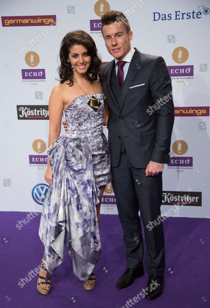 Katie Melua, James Toseland British singer with georgiian roots, Katie Melua, left, and her husband, superbike champion James Toseland, arrive for the German Echo music award ceremony in Berlin, Germany