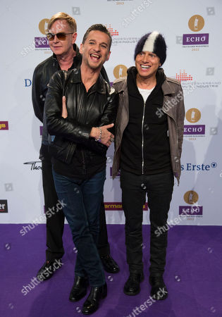 Dave Gahan British singer Dave Gahan, center, and and members of his band Depeche Mode, Andrew Fletcher, left, and Martin Lee Gore, right, arrive for the German Echo music award ceremony in Berlin, Germany