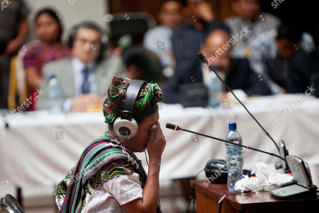 Ana De Leon Lopez, an Ixil Maya Indian, cries as she testifies during the genocide trial of former dictator Jose Efrain Rios Montt in Guatemala City, . Rios Montt, the first Latin American strongman to be tried on genocide charges in his own country, seized power in a March 23, 1982, coup, and ruled until he himself was overthrown just over a year later. Prosecutors say that while in power he was aware of, and thus responsible for, the slaughter by subordinates of at least 1,771 Ixil Mayas in San Juan Cotzal, San Gaspar Chajul and Santa Maria Nebaj, towns in the Quiche department of Guatemala's western highlands
