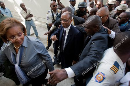 Jean Bertrand Aristide Former Haitian President Jean-Bertrand Aristide, center, arrives at the courthouse for a closed session before an investigative magistrate in Port-au-Prince, Haiti. . Aristide testified before a judge investigating the slaying of one of the country's most prominent journalists. The judge is questioning Aristide about the killing in April 2000 of Jean Dominique, a friend of the former president