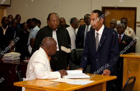 """Jean-Claude """"Baby Doc"""" Duvalier Former Haitian dictator Jean-Claude Duvalier, known as """"Baby Doc,"""" standing right, attends his hearing at court in Port-au-Prince, Haiti, . Duvalier appeared in court Thursday after three times shunning a summons for a hearing on whether he should be charged with human rights abuses during his brutal 1971-1986 regime"""