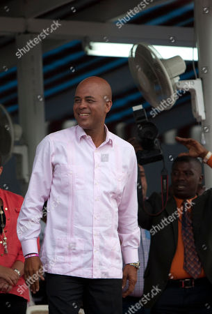 "Michel Martelly Haiti's President Michel Martelly stands before supporters at an event marking his two years in office in Port-au-Prince, Haiti, . Martelly, a former pop star known as ""Sweet Micky"" who was famous for his raunchy stage antics, spent his first year trying to install a government with an opposition-controlled Parliament. The second year was largely spent trying to implement government projects, many of them heavily focused on courting foreign investors and tourists"