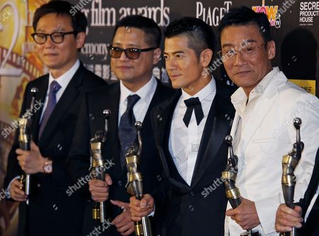 Sunny Luk Kim Ching, LongmanLeung, Wong Hoi, Tony Leung Ka Fai, Aaron Kwok From right, Hong Kong actor Tony Leung Ka Fai, Aaron Kwok, director Longman Leung and Sunny Luk Kim Ching, pose with their awards for Best Film, Best director and Best Actor in the movie 'Cold War ' at the 32nd Hong Kong Film Awards in Hong Kong