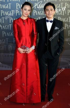 Carina Lau, Tony Leung Chiu Wai Hong Kong actress Carina Lau and actor Tony Leung Chiu Wai pose on the red carpet of the 32nd Hong Kong Film Awards in Hong Kong