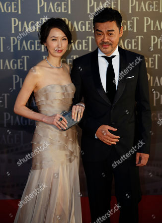 Sean Lau, Amy Kwok Hong Kong actor Sean Lau, nominated for the Best Actor award, poses with his wife, actress Amy Kwok for photographers on the red carpet of the 32nd Hong Kong Film Awards in Hong Kong