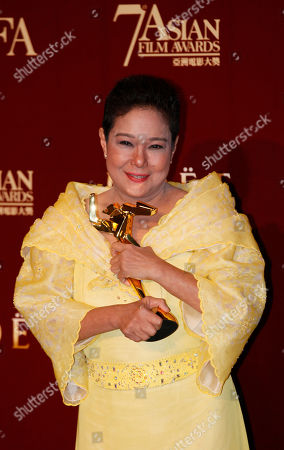 """Nora Aunor The Philippines actress Nora Aunor poses with her trophy after winning the Best Actress Award of her movie """"Thy Womb"""" at the Asian Film Awards as part of the 37th Hong Kong International Film Festival in Hong Kong"""