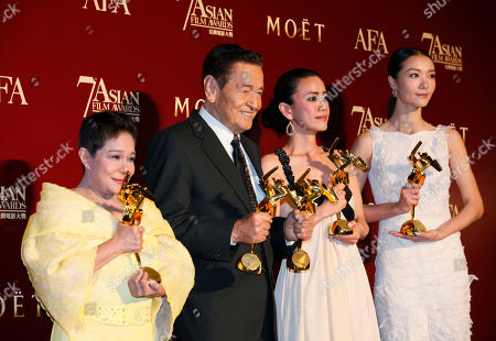 Nora Aunor, Eddie Garcia, Makiko Watanabe, Qi Xi From left, Philippines actress Nora Aunor, Philippines actor Eddie Garcia, Japanese actress Makiko Watanabe and Chinese actress Qi Xi pose with their trophies after winning the Best Actress Award, Best Actor Award, Best Supporting Actress Award and Best Newcomer Award at the Asian Film Awards as part of the 37th Hong Kong International Film Festival in Hong Kong