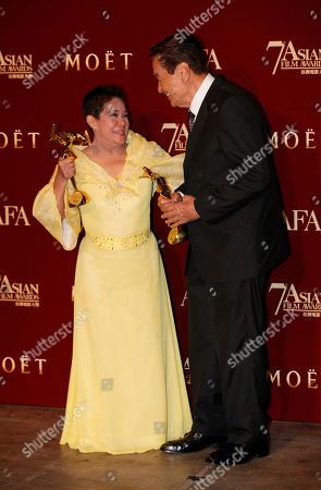 """Nora Aunor, Eddie Garcia Philippines actress Nora Aunor, left and Philippines actor Eddie Garcia pose with their trophies after winning the Best Actress Award of her movie """"Thy Womb"""" and Best Actor Award of his movie """"Bwakaw"""" at the Asian Film Awards as part of the 37th Hong Kong International Film Festival in Hong Kong"""