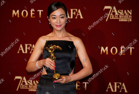 "Cho Min-soo South Korea actress Cho Min-soo poses with her trophy after winning the People's Choice for Favorite Actress Award of her movie ""Pieta"" at the Asian Film Awards as part of the 37th Hong Kong International Film Festival in Hong Kong"
