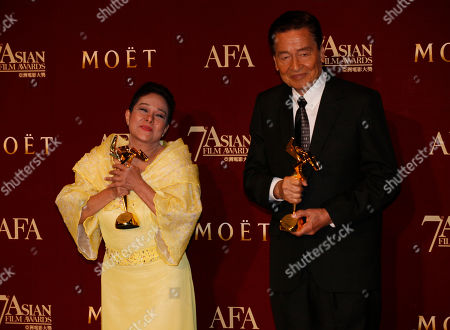 """Nora Aunor, Eddie Garcia The Philippines actress Nora Aunor, left and Philippines actor Eddie Garcia pose with their trophies after winning the Best Actress Award of her movie """"Thy Womb"""" and Best Actor Award of his movie """"Bwakaw"""" at the Asian Film Awards as part of the 37th Hong Kong International Film Festival in Hong Kong"""