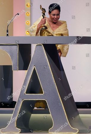 Stock Picture of Actress Nora Aunor of the Philippines reacts after receiving the Best Actress award at the Asian Film Awards in Hong Kong