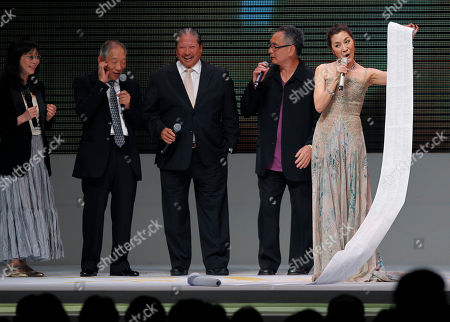 Mabel Cheung, Yuen Wo-ping, Corey Yuen, Sammo Hung, Michelle Yeoh Malaysian actress Michelle Yeoh, right, displays a long list of people to thank after receive the Excellence in Asian Cinema award at the Asian Film Awards in Hong Kong . From left are Hong Kong director Mabel Cheung, action director Yuen Wo-ping, Corey Yuen, Sammo Hung