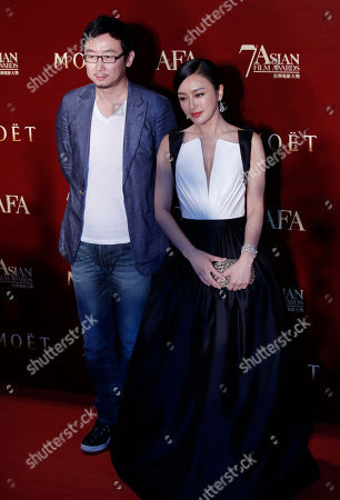 Lu Chuan, Qin Lan Chinese film director Lu Chuan, left, and actress Qin Lan pose on the red carpet at the Asian Film Awards as part of the 37th Hong Kong International Film Festival in Hong Kong