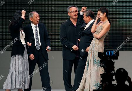 Mabel Cheung, Yuen Wo-ping, Corey Yuen, Sammo Hung, Michelle Yeoh Malaysian actress Michelle Yeoh, right, reacts before receiving the Excellence in Asian Cinema award at the Asian Film Awards in Hong Kong . From left are Hong Kong director Mabel Cheung, action director Yuen Wo-ping, Corey Yuen, Sammo Hung